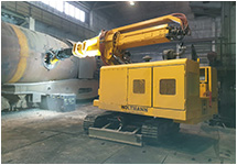 Debricking machines with lifting arm